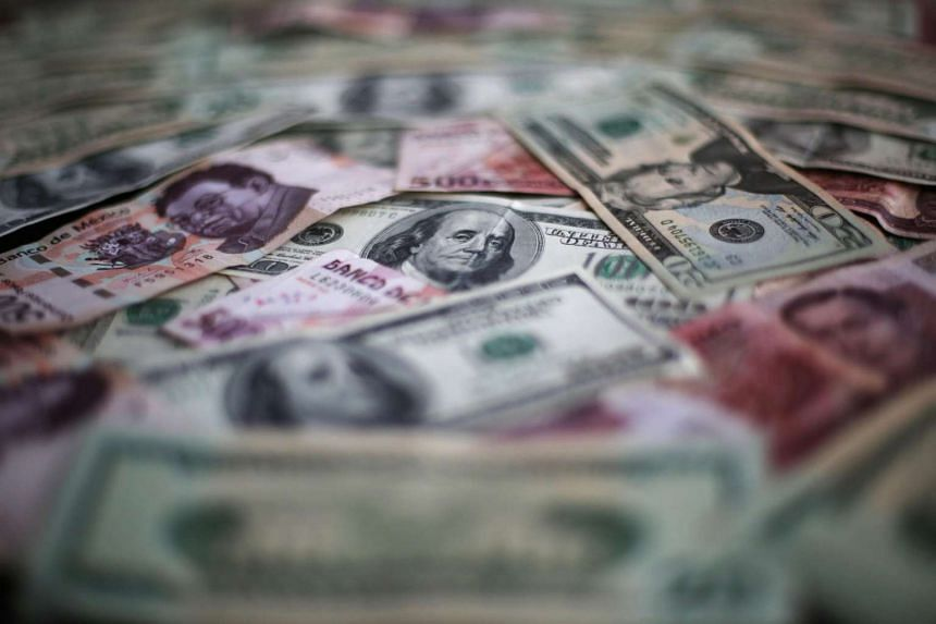 Mexican pesos and US dollar banknotes are seen in this picture illustration.