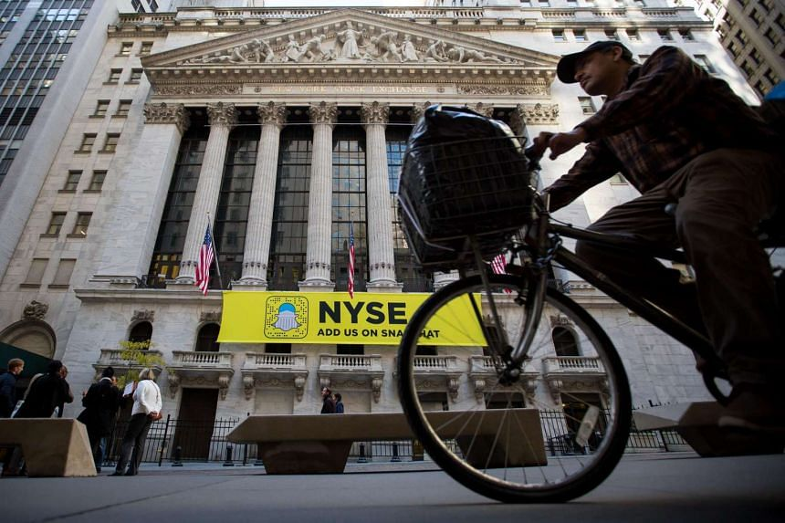A man rides a bicycle past the New York Stock Exchange (NYSE) in New York, US, on Friday, Nov 4, 2016.