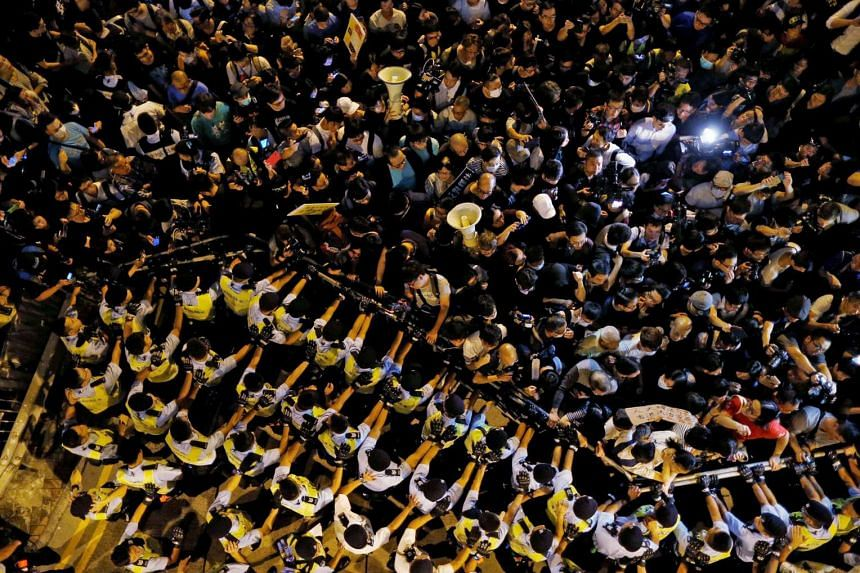 Tens of thousands of protesters marched towards Liaison Office of the Central People's Government in Hong Kong, causing massive disruptions to traffic and police having to form human barricades to stop the crowd from moving towards their destination.
