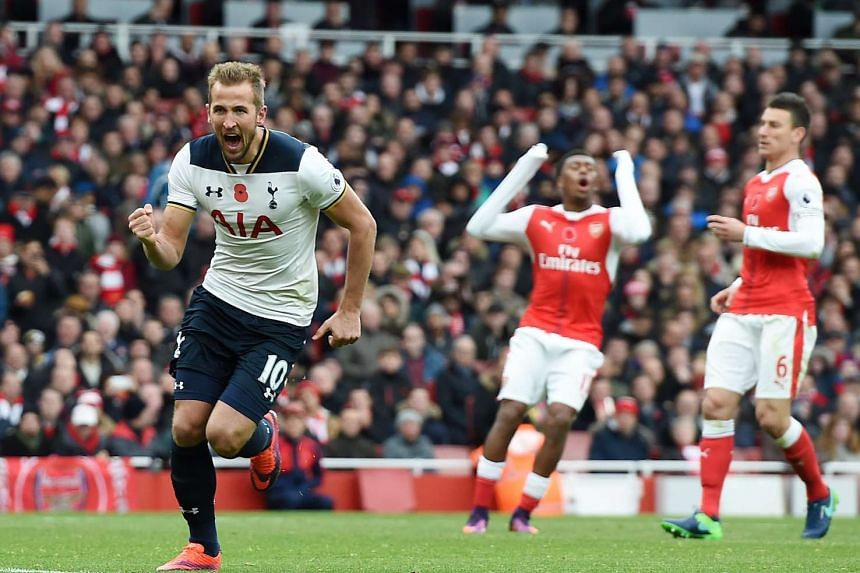 Tottenham's Harry Kane (left) celebrates after scoring from the penalty spot during the English Premier League soccer match Arsenal vs Tottenham at the Emirates Stadium in London, Britain, on Nov 6, 2016.