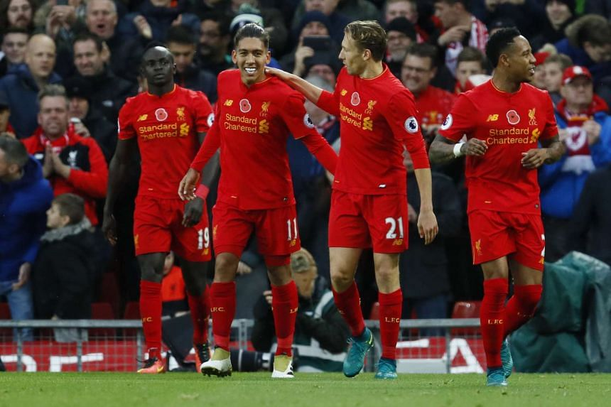 Roberto Firmino (second from left) celebrates scoring Liverpool's fourth goal against Watford.