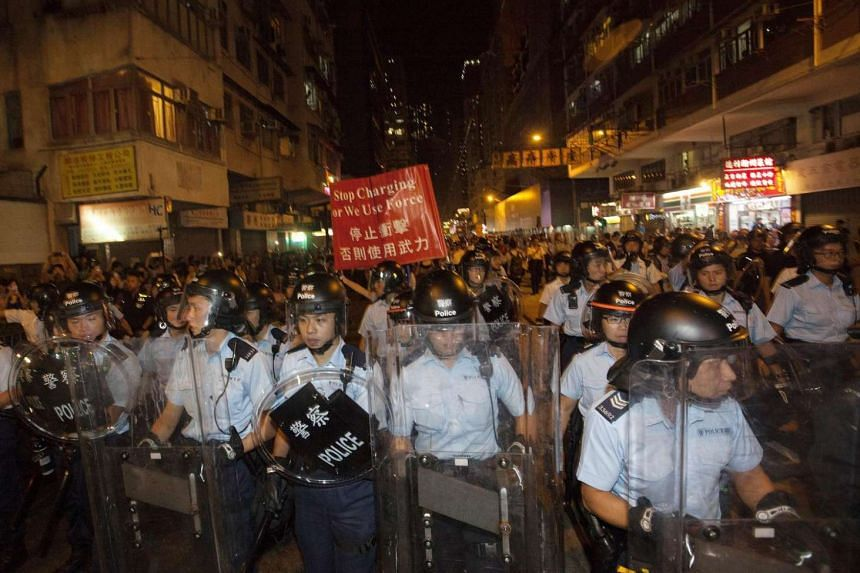 Anticipation over the ruling has reached a fever pitch in Hong Kong following overnight clashes outside the central government's liaison office in the city.