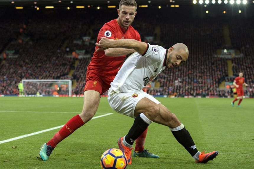 Watford's Nordin Amrabat (right) in action with Liverpool's Jordan Henderson during the English Premier League soccer match between Liverpool and Watford at Anfield, Liverpool, Britain on Nov 6, 2016.