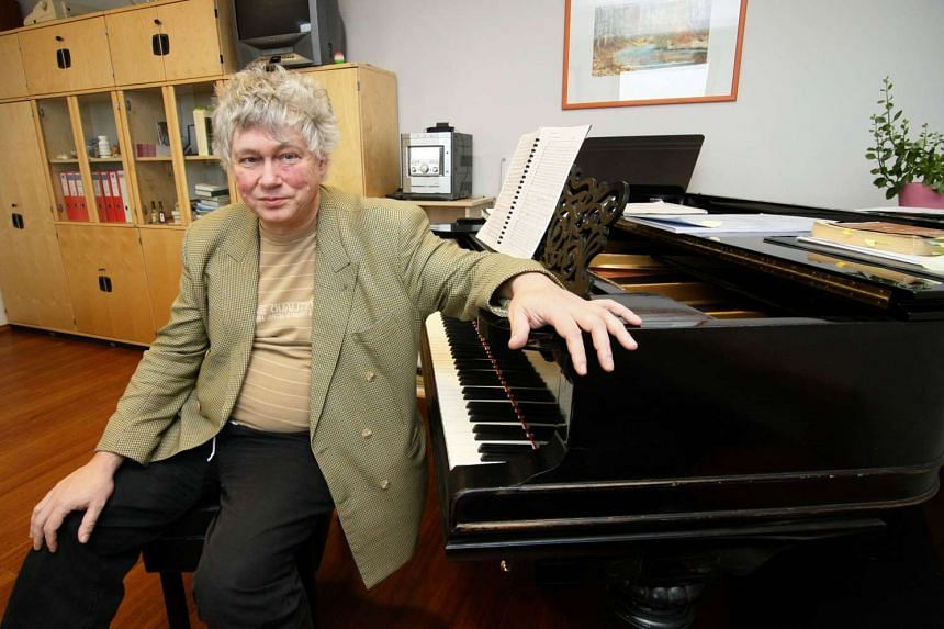 This file photo taken on Nov 5, 2009 shows Hungarian pianist, conductor composer and director of the 'Hungarian Philharmonic' orchestra Zoltan Kocsis posing beside his piano in Budapest.