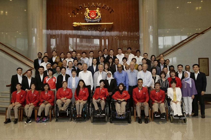 Prime Minister Lee Hsien Loong and Members of Parliament taking a group photo with Team Singapore Paralympians at the Parliament House on Nov 7, 2016.