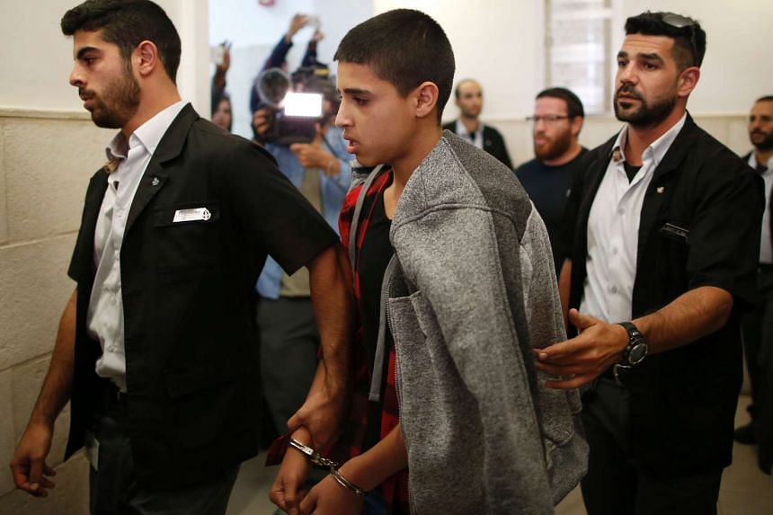 Ahmed Manasra (centre) leaving the District Court in Jerusalem after his sentencing hearing on Nov 7, 2016.