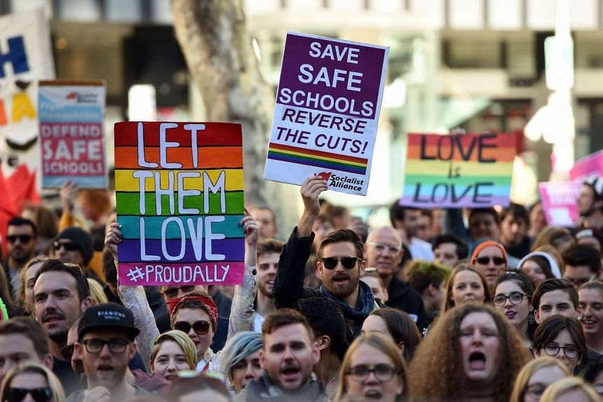 Pro-gay marriage supporters attending a rally in Sydney on June 25, 2016.
