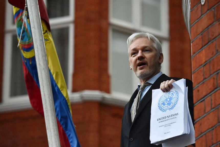 WikiLeaks founder Julian Assange addressing the media from the balcony of the Ecuadorian embassy in central London on Feb 5, 2016.