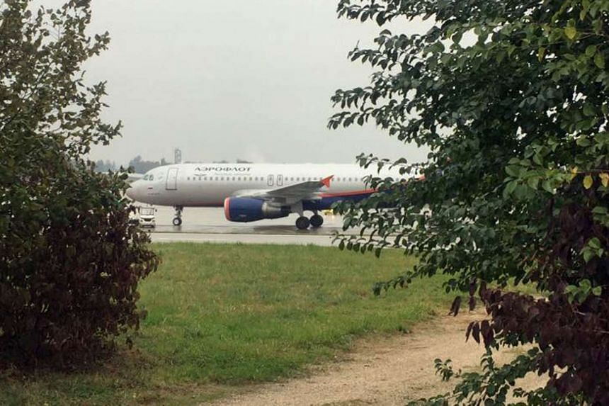 The Aeroflot passenger plane after being evacuated due to a bomb scare at Geneva airport on Oct 13, 2016.