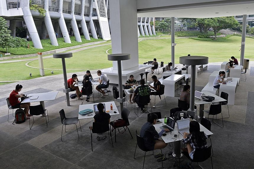 Students studying at the National University of Singapore University Town. With NUS expanding its residential college model, where students live and learn with professors, half of the freshmen can spend at least one year living and learning on campus