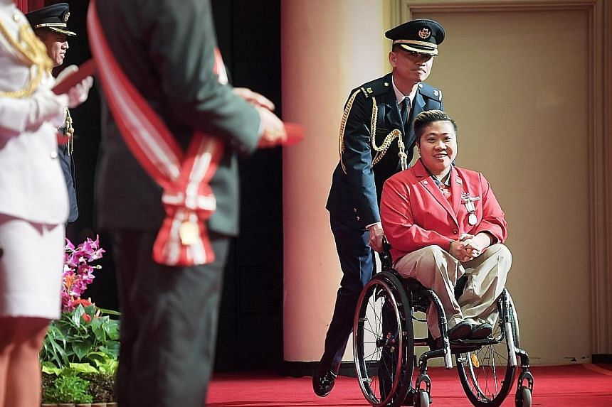 Left: Mr Peter Ho, former head of the civil service, receiving the Distinguished Service Order, one of Singapore's top national honours, from President Tony Tan Keng Yam yesterday, for his service to the country. Below: Para-swimmer Theresa Goh, who