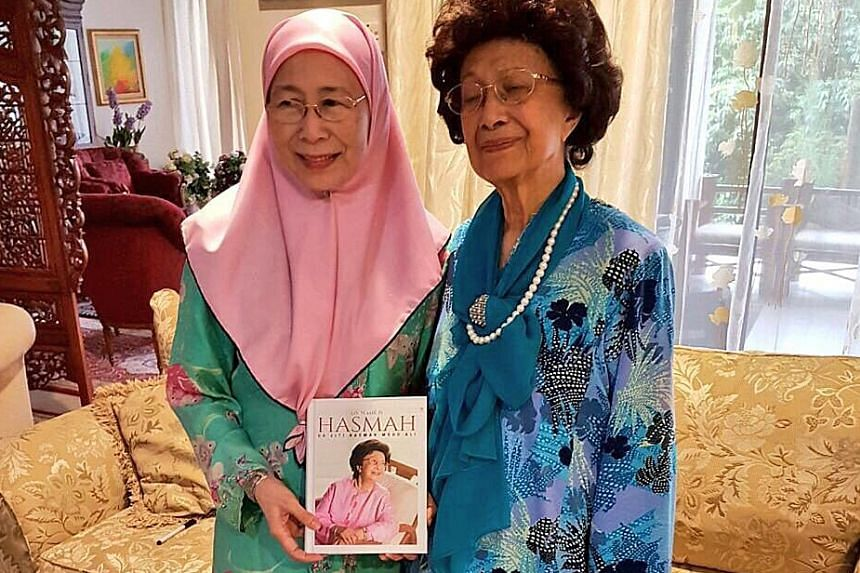 Tun Dr Mahathir's wife, Tun Siti Hasmah Mohamad Ali (right), with Anwar Ibrahim's wife, Dr Wan Azizah Wan Ismail, at the latter's home. She gave Dr Wan Azizah a copy of her biography, My Name Is Hasmah.