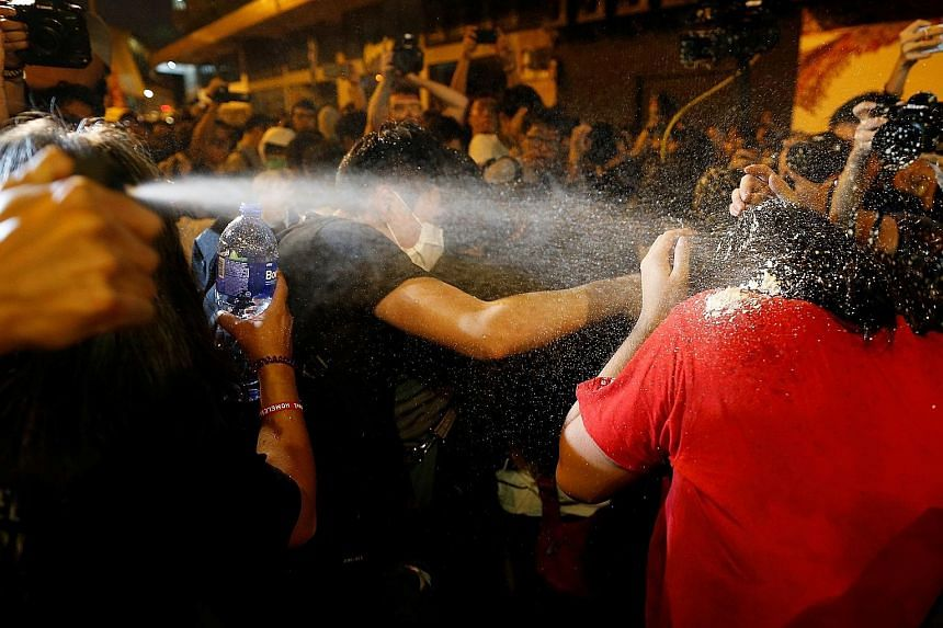 Police using pepper spray to disperse protesters during yesterday's protest in Hong Kong. As of 10pm, at least four groups of protesters were still in stand-offs with police. Protesters facing off against police in Hong Kong last night, the eve of a