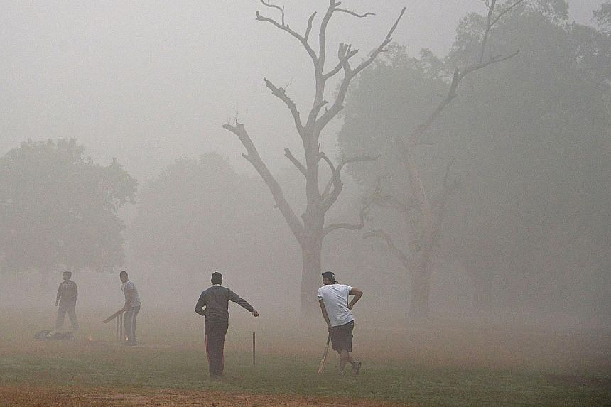 Life went on as usual yesterday in New Delhi, even as the city continued to struggle with one of the worst spells of air pollution in recent years. Young runners took part in the New Delhi 10K Challenge (above) amid the severe air pollution, while ad