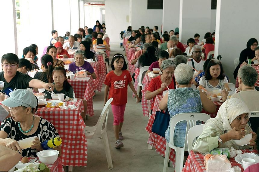 Almost 300 Marsiling residents were treated to a breakfast of lontong and sayur lodeh, traditional Malay dishes, at the void deck of Block 16, Marsiling Lane, yesterday. The breakfast, organised by the Marsiling Women's Executive Committee and the Ma
