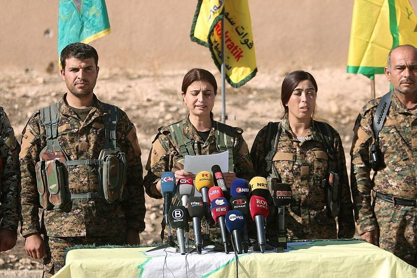 Officers of the Syria Democratic Forces at a news conference in Ain Issa, in the Raqqa governorate, yesterday.