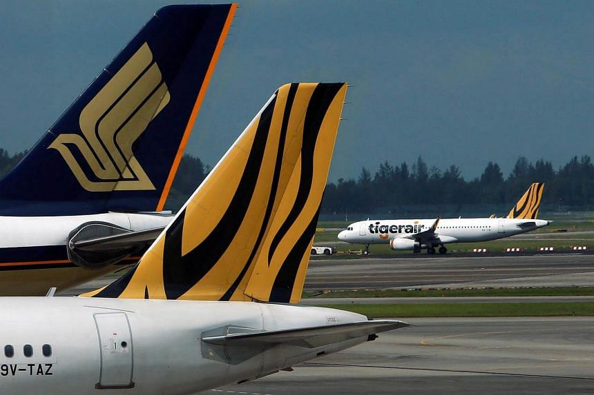 A Tiger Airways plane is towed on the runway at Changi Airport in Singapore.