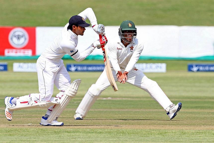 Sri Lanka batsman Dhananjaya de Silva (left) is in action as Brian Chari escapes a ball during the first day of the second cricket Test match between Sri Lanka and hosts Zimbabwe, on Nov 6, 2016.