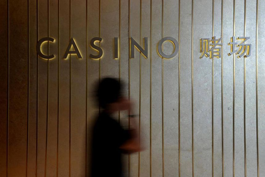 Three gamblers agreed to pay back their winnings to Marina Bay Sands due to a glitch in the casino's loyalty membership scheme.