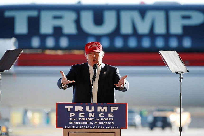 Mr Donald Trump rallying supporters in a cargo hangar at Saint Paul International Airport in Minneapolis, Minnesota, on Nov 6.
