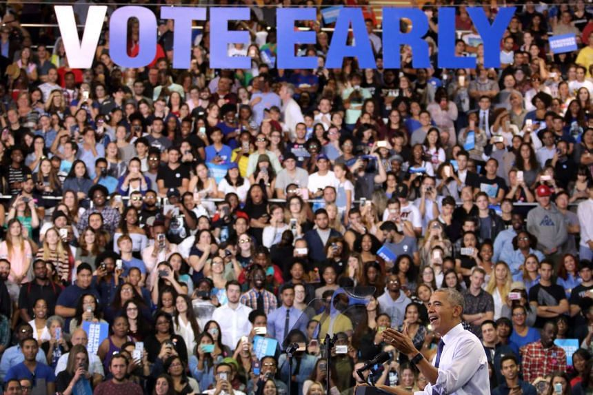 US President Barack Obama (right) speaks during a rally for Democratic presidential candidate Hillary Clinton at Florida International University on Nov 3, 2016.