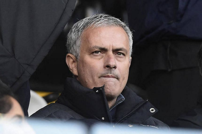 Manchester United manager Jose Mourinho looks on from the stands during the Premier League.