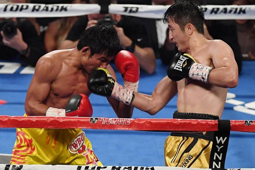 Zou Shiming (right) throws a right at Prasitsak Phaprom in the eighth round of their WBO flyweight championship fight at the Thomas & Mack Center on Nov 5, 2016, in Las Vegas, Nevada.