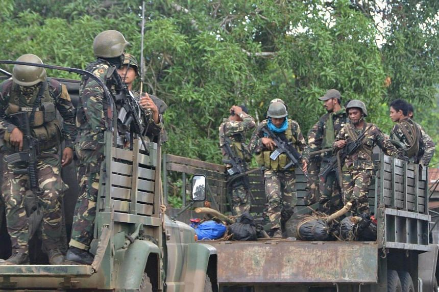This photo taken on Aug 27, 2016 shows Philippine soldiers standing guard aboard a vehicle loaded with bodies of Abu Sayyaf members killed.