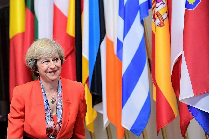 British Prime Minister Theresa May looks on as she leaves the European Union leaders summit on Oct 21, 2016.