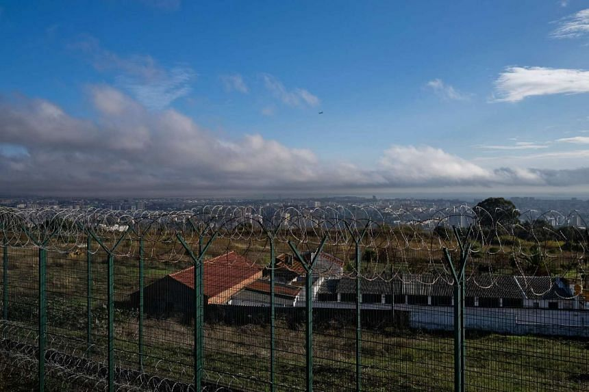 A picture taken from the rooftop of the high security prison establishment of Monsanto shows the prison kennel facilities outside the walls of the main building in Lisbon on Oct 24, 2016.