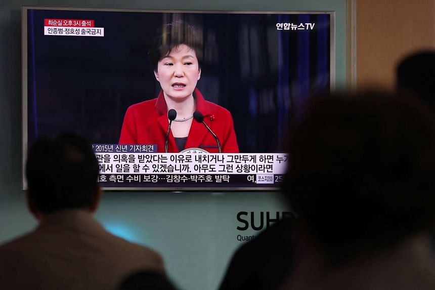 People watch a television screen showing an image of Park Geun Hye, South Korea's president, during a news broadcast at Seoul Station in Seoul on Oct 31, 2016.