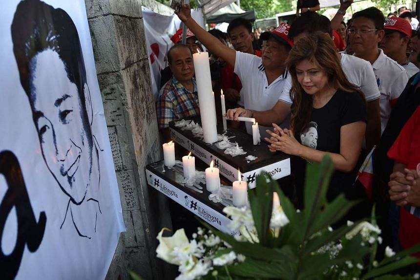Imee Marcos, daughter of the late dictator Ferdinand Marcos, offers prayers alongside supporters at a vigil for her father in front of the Supreme Court in Manila on Oct 17, 2016.