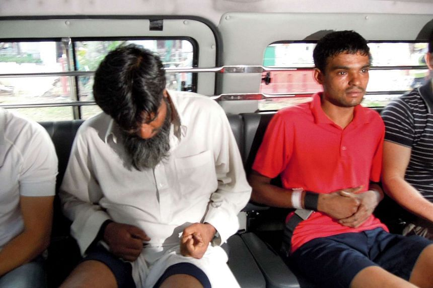Rasheed Muhammad (left) and Ramzan Rizwan, both from Pakistan, were charged with murder on June 14, 2014 in connection with a legless body found in a suitcase on Syed Alwi Road on June 11, 2014.
