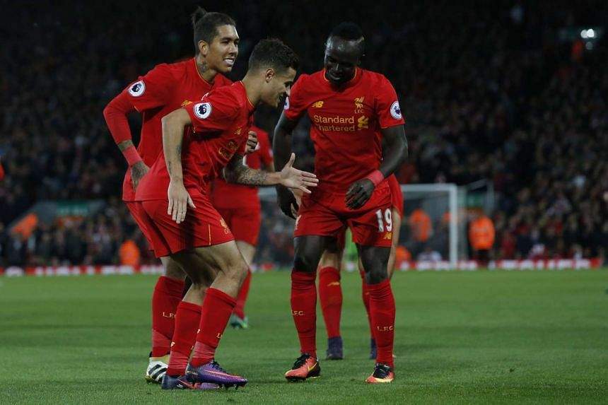Liverpool's Philippe Coutinho celebrates scoring their second goal with Sadio Mane and Roberto Firmino during the Premier League match against West Bromwich Albion on Oct 22, 2016.