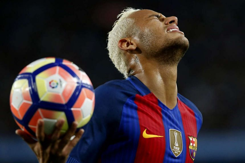 Barcelona's Brazilian forward Neymar gestures after missing a goal opportunity during the Spanish league football match between FC Barcelona vs Atletico de Madrid.