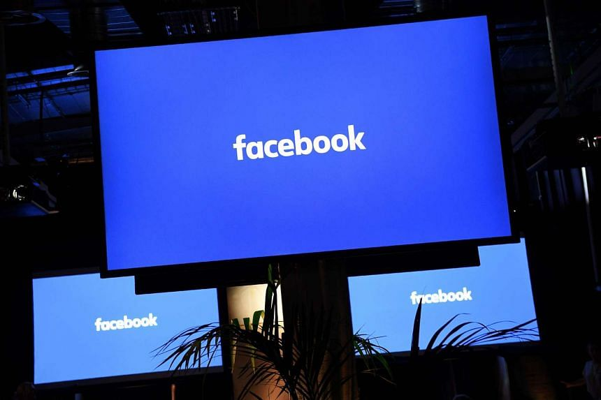 This file photo taken on Oct 10, 2016 shows a Facebook logo on a screen ahead of a press conference in central London.