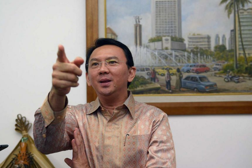 File photograph of Jakarta governor Basuki Tjahaja Purnama, known by his nickname Ahok, speaking to journalists at his office in Jakarta.