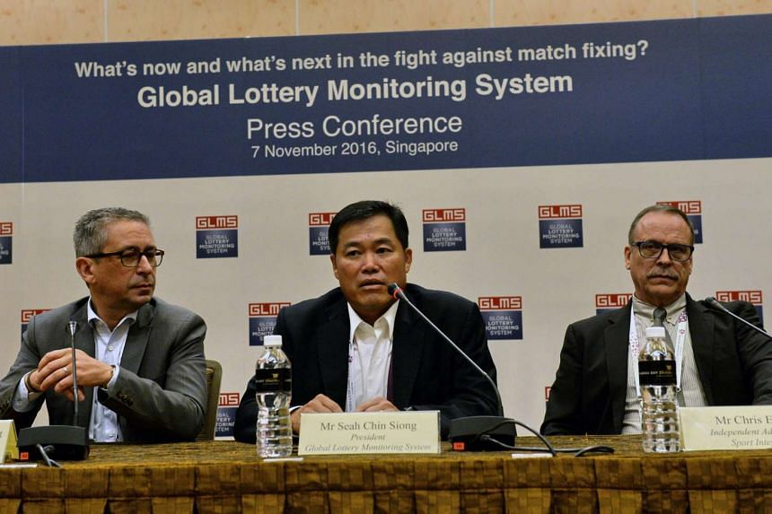(Left to right) President of World Lottery Association Jean-Luc Moner-Banet, GLMS President and Singapore Pools CEO Seah Chin Siong and Independent Advisor on Sports Integrity Chris Eaton attend the Global Lottery Monitoring System (GLMS) press confe
