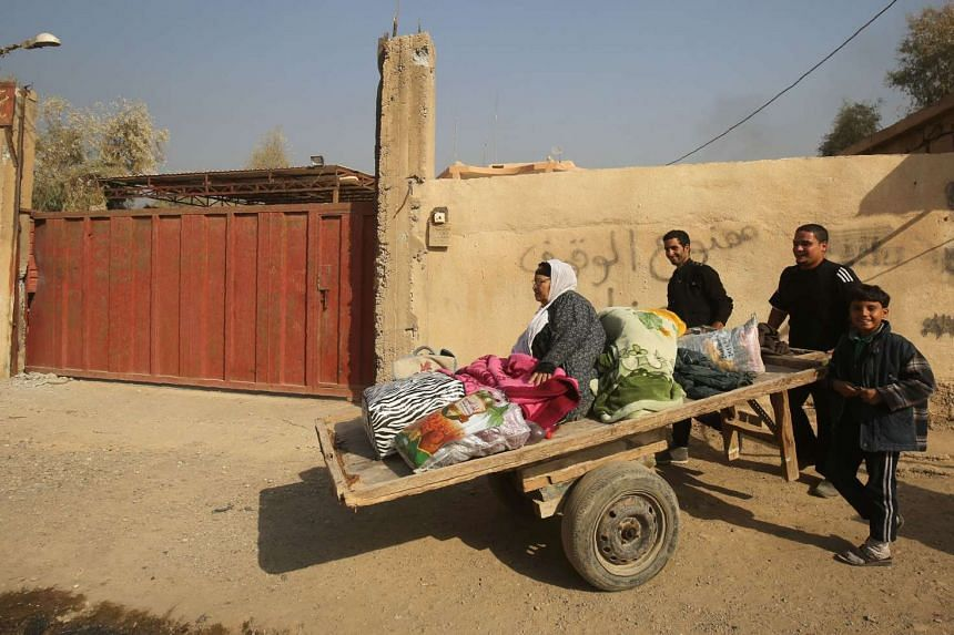 Iraqi families displaced from the Hamam al-Alil area, about 14 kilometres from the southern outskirts of Mosul, return on Nov 7, 2016 to their homes after the recapture of their village by Iraqi forces from ISIS jihadists during the ongoing operation