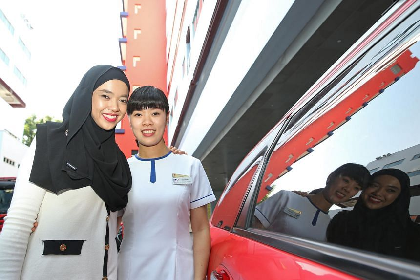 NUH senior staff nurse Nurhana bte Mohamad and Mrs Xue Dan (nursing student, Nanyang Polytechnic) were the first to attend to a man who collapsed on a train.