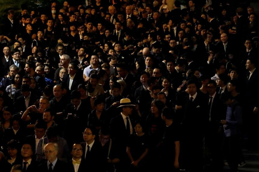 Hundreds of lawyers dressed in black staging a silent protest in Hong Kong on Nov 8, 2016.