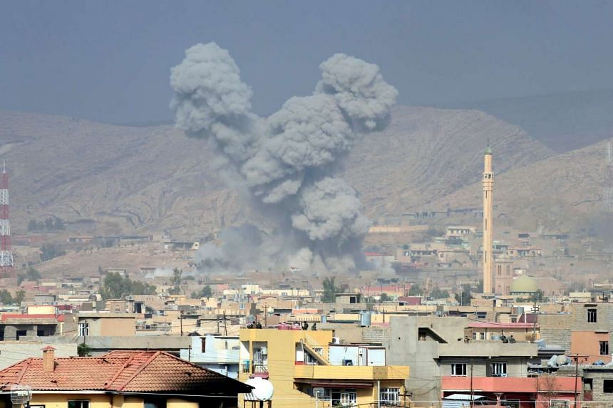 Smoke rises from the town of Bashiqa, near Mosul, during clashes between Kurdish forces and ISIS militants, on Nov 8, 2016.