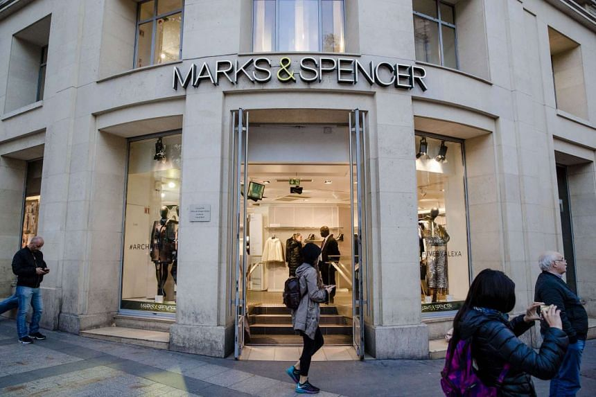 Pedestrians pass the Marks & Spencer department store on Champs-Elysees avenue in Paris on Nov 2, 2016.