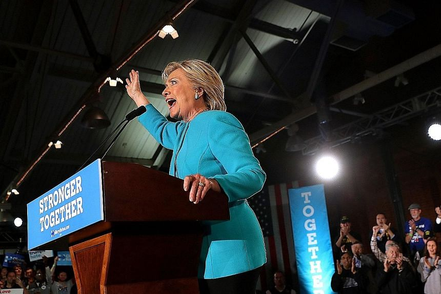 Mrs Clinton speaking at a rally in New Hampshire on Sunday. According to a polling average by political website RealClearPolitics, her lead over Mr Trump fell to a low of 1.9 percentage points in the days after FBI director James Comey's initial anno