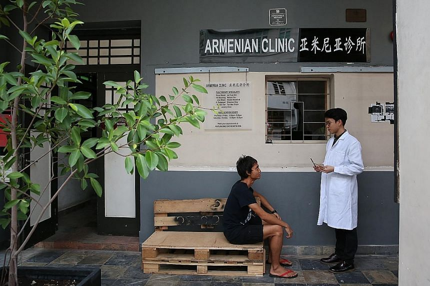 """Home-grown film-maker Jeremy Chua (above, right) is one of 11 """"film therapists"""" at the film therapy clinic at The Substation; and artist Ang Song Ming's interactive work, Piece For 350 Onomatopoeic Molecules."""