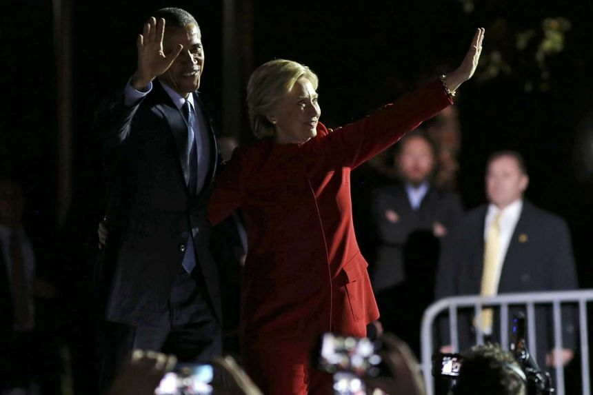 US President Barack Obama and US Democratic presidential nominee Hillary Clinton greets supporters on stage during a campaign event for in Philadelphia.
