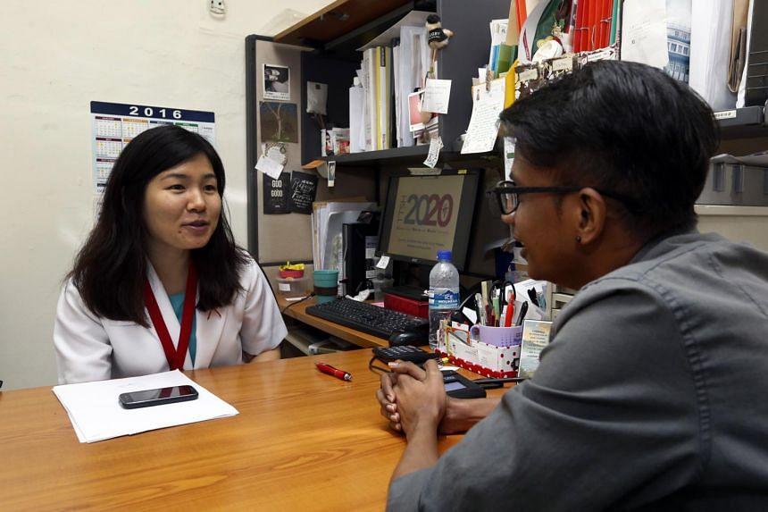 Social worker Lin Jingyi (left) was awarded the Promising Social Worker Award on Nov 8, 2016.