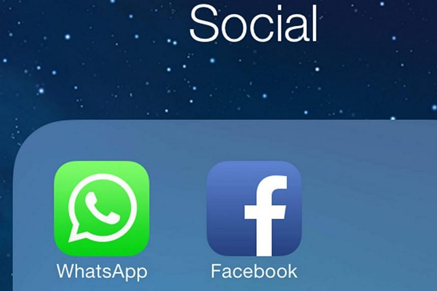 The Facebook and WhatsApp app icons displayed on an iPhone in New York.