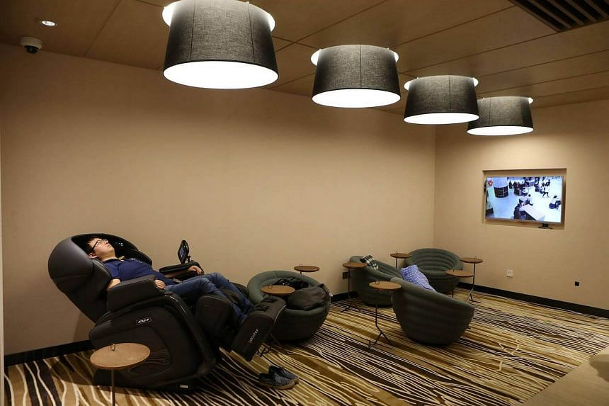 Vanke Mall's 'husband nursery' is equipped with massage chairs, a fridge and magazines.