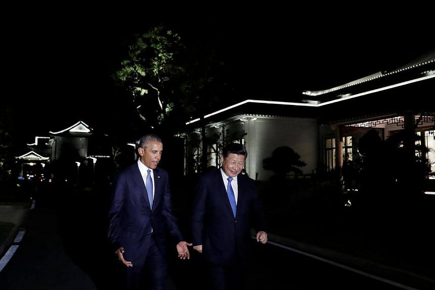 US President Barack Obama and China President Xi Jinping walk together at West Lake State Guest House in Hangzhou, in eastern China's Zhejiang province, on Sept 3, 2016.